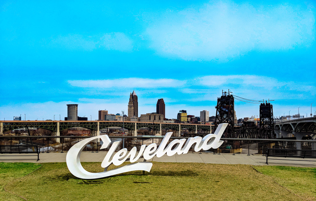 cleveland sign in front of city of cleveland