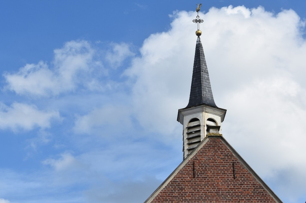 church roof top against blue sky background